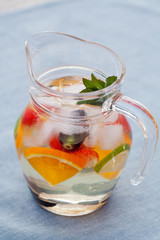 Refreshing white sangria (punch) with fruits, picnic idea