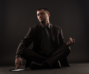 Impatient businessman can not meditate