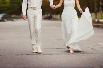 Bride and groom are holding hands and, lifestyle-concept