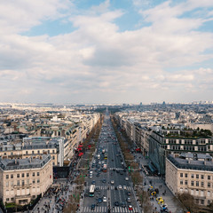Aerial view of the city and Champs Elysees with blue cloudy sky