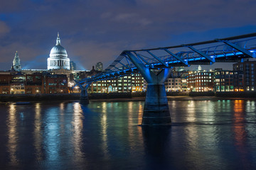 Millennium bridge and St Paul cathedral at dusk.