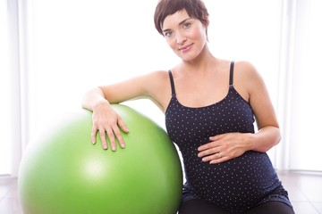 Pregnant woman keeping in shape