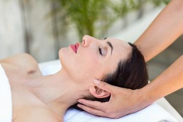 Brunette receiving head massage