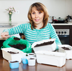 Ordinary woman  making  ground  for sprouts