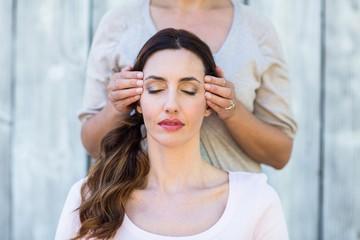 Woman getting reiki therapy