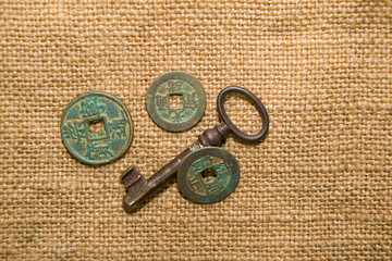 Antique  coins  and keys  on old cloth