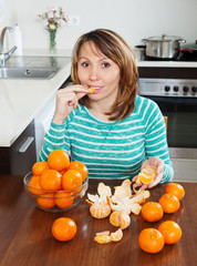 woman eating mandarins