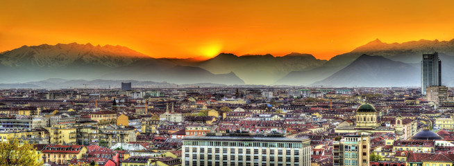 Sunset over the Alps and Turin city - Italy