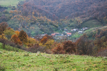 view of a village in a valley during autumn