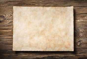 antique parchment on aged dark wood