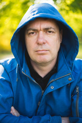 Man portrait in hooded sweatshirt
