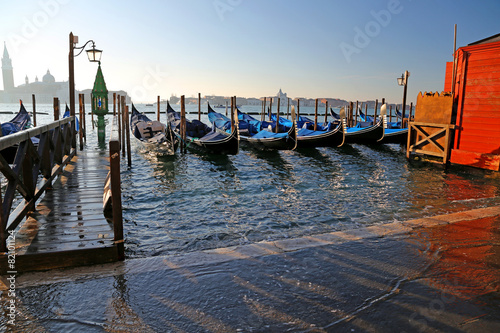 Plexiglas Gondolas gondolas in Venice in Italy during high tide