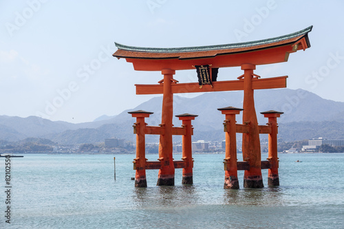 Red torii in shallow water near island of Miyajima, Japan - 82102550