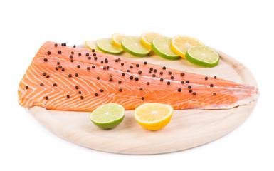 Raw salmon steak on cutting board.