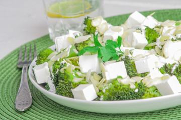Broccoli salad with feta cheese and almonds