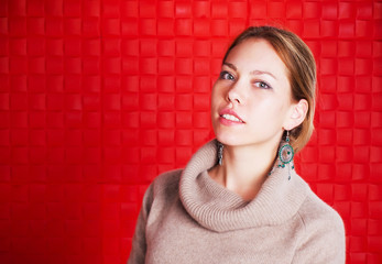 Young woman on a red background