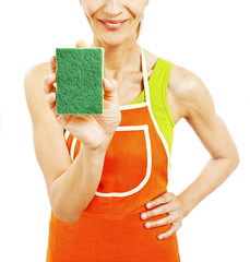 Homemaker in an apron holding a sponge washer