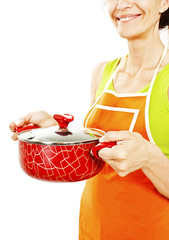 Homemaker in an apron holding pan with ready meal, soup