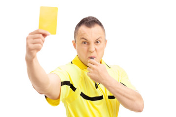 Football referee showing a yellow card