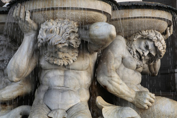 Tritones support the Danube Fountain in Vienna, Austria.