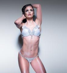 fitness woman wearing bikini wet