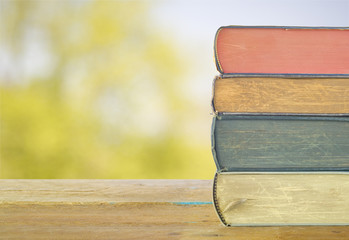 stack of books, nature background,free copy space