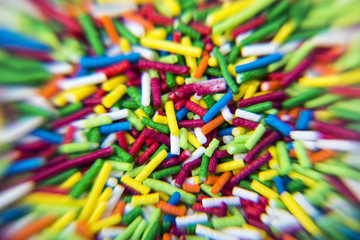 Macro of Sugar colorful sticks powder background