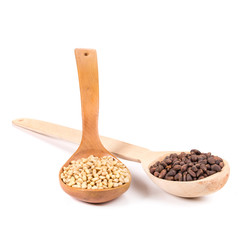 Pine nuts in a wooden spoon.