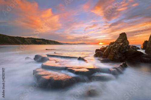 rock in Azkorri beach at sunset - 82107987