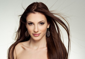Close-up of pretty female salon model with flying hair