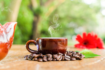 Coffee in a mug & Kettle with beans flower and leaves