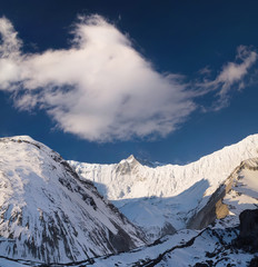 High mountain peak during sundown. Natural landscape