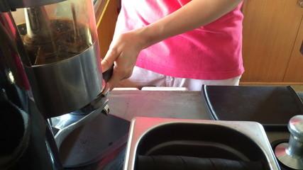 Barista presses the coffee for espresso-Dolly shot