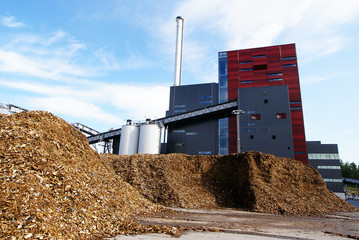 bio power plant with storage of wooden fuel (biomass) against bl