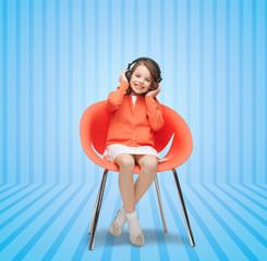 happy little girl listening to music in headphones