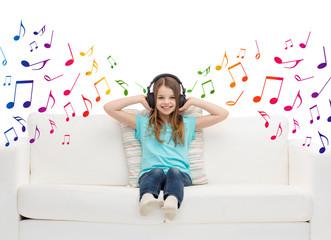 happy girl in headphones listening to music
