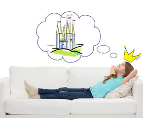 smiling little girl lying on sofa and dreaming
