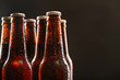 Glass bottles of beer on dark background - 82113711