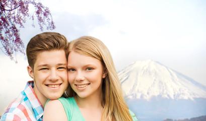 smiling couple hugging over fuji mountain in japan