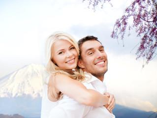 couple having fun  over fuji mountain in japan