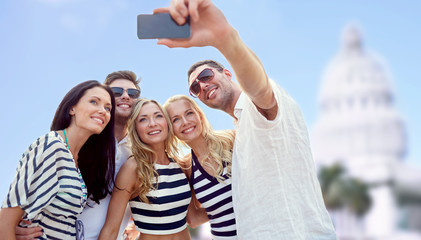 friends taking selfie with smartphone