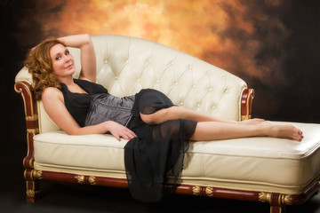 Beautiful adult sexy woman sitting on chair