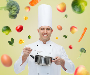 happy male chef cook with pot and spoon