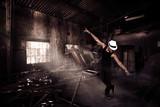 African guy is dancing in ruins