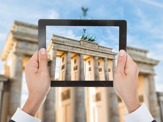 Person Hand Photographing Brandenburg Gate