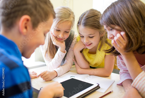 group of school kids with tablet pc in classroom - 82114982