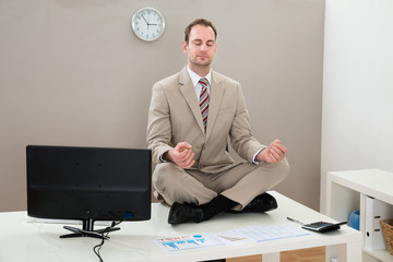 Businessman Meditating With Eyes Closed