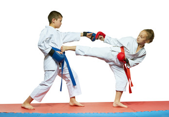 Girl with a red belt kick the boy in the stomach