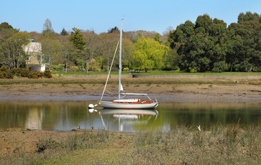 Moored yacht on the river Beaulieu River in Hampshire