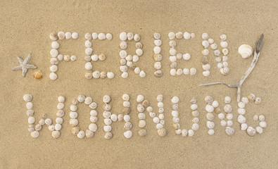 Wort FERIENWOHNUNG im Sand